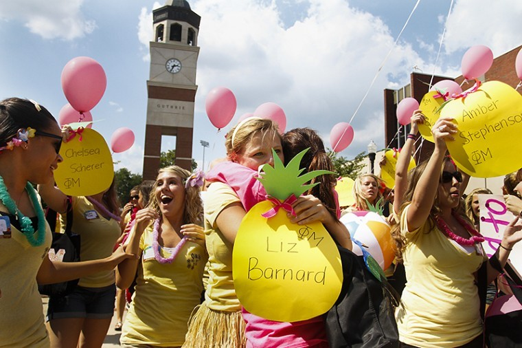 Phi Mu sisters meet and congratulate their newest members Sunday outside of Mass Media and Technology Hall during sorority bid day.