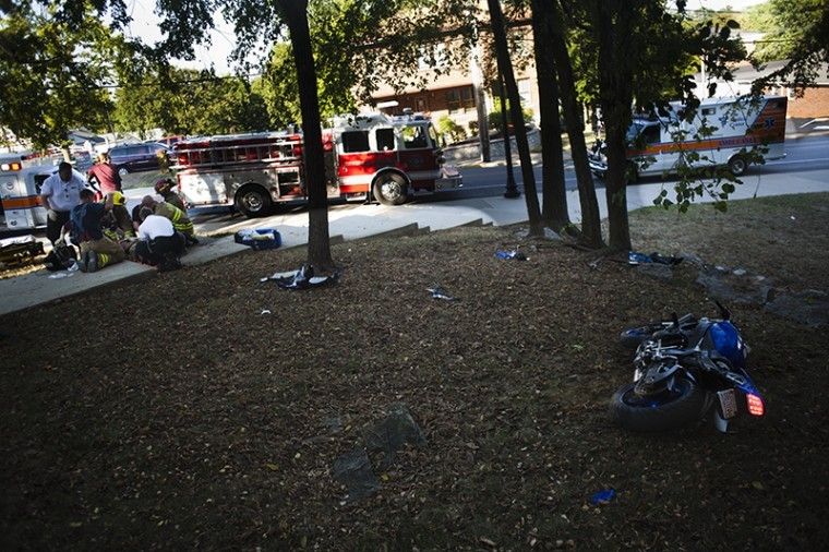 An unidentified motorcyclist crashed Friday outside of College High Hall on College Heights Boulevard. The man, bleeding from the head, was transported from the scene by ambulance.
