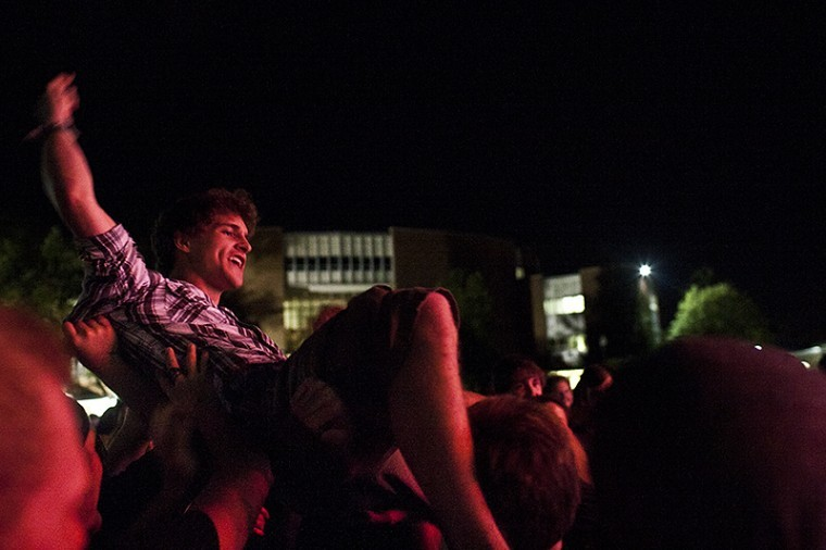 La+Grange+freshman+Zach+Scott+crowd+surfs+Thursday+during+Philip%0A7%27s+performance+at+the+M.A.S.T.E.R.+Plan+concert+on+the+South%0ALawn.%0A