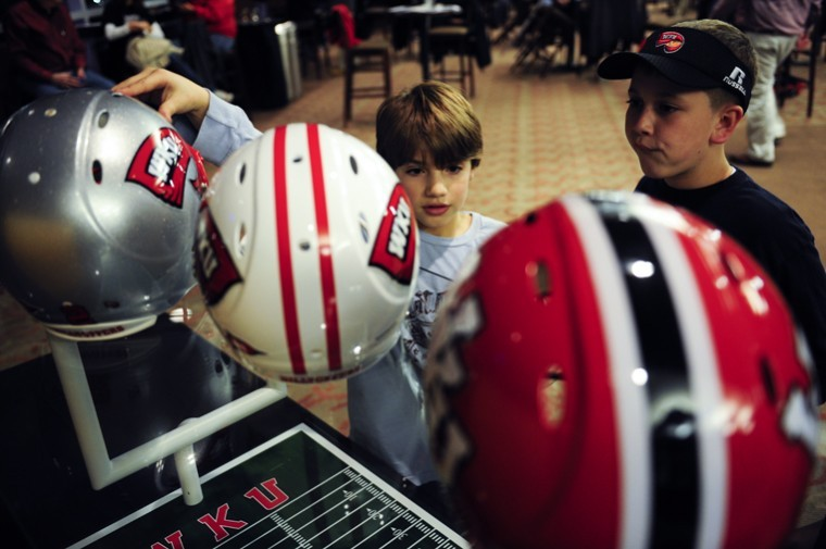 Ten-year-old+Clayton+Bush+of+Bowling+Green%2C+left%2C+admires+the%0Anew+white+football+helmet+amongst+WKU%27s+past+two+helmets+with%0Afriend+Mason+Graves%2C+10%2C+of+Bowling+Green+during+the+National%0ASigning+Day+party+held+in+the+Topper+Club+in+February.+New+uniforms%0Awill+be+unveiled+on+Friday.%0A