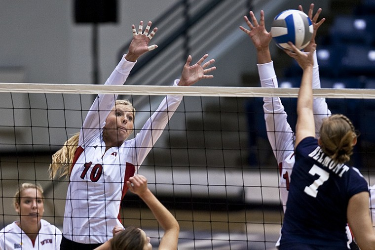 WKU senior Lindsay Williams reaches for a block Saturday against Belmount Bruins sophomore Jen Myer in the third set of the teams' match at the Curb Event Center in Nashville. The Lady Toppers ran their record to 3-0 on the season with a pair of wins, the other against Murray State.