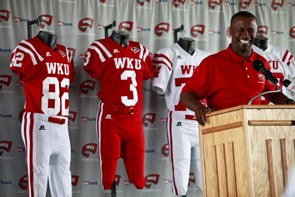 Head+Coach+Willie+Taggart+on+Friday+talked+about+WKU%27s+new%0ARussell+Athletic+jerseys+the+Toppers+will+wear+this+fall+at+the%0ATopper+Club+in+Smith+Stadium.+WKU+also+announced+a+four-year%2C%0A%241.735+million+extension+with+Russell.%0A