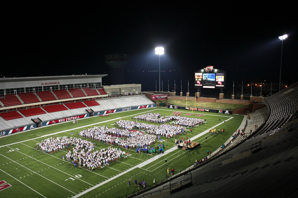 The traditional class photo was taken at Sunday nights M.A.S.T.E.R. Plan opening ceremonies at Smith Stadium.