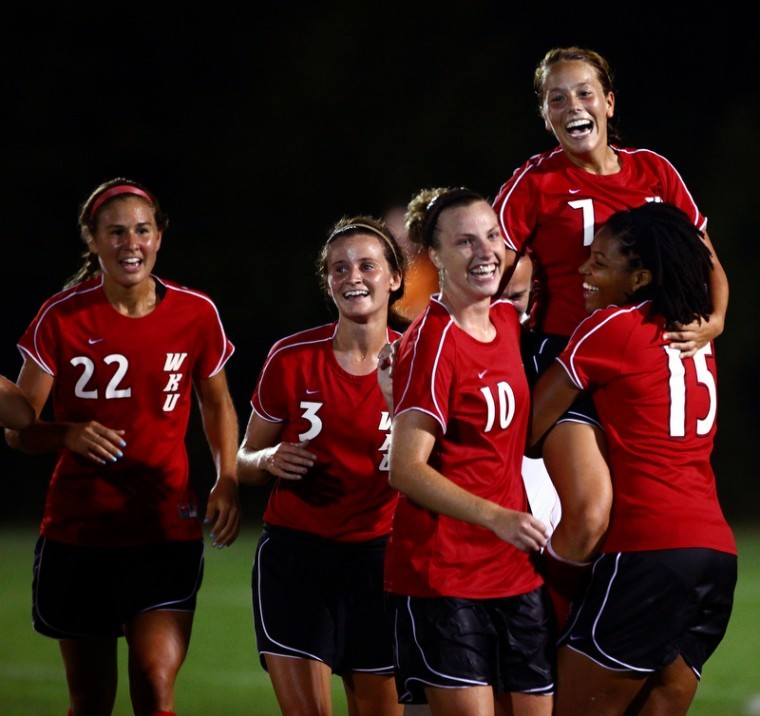 Freshman+forward+Leslie+Chinn+celebrates+her+game-winning%2C%0Aovertime+goal+on+the+shoulders+of+her+teammates+after+the+Lady%0AToppers+1-0+win+over+Western+Carolina+in+their+season-opener%0A