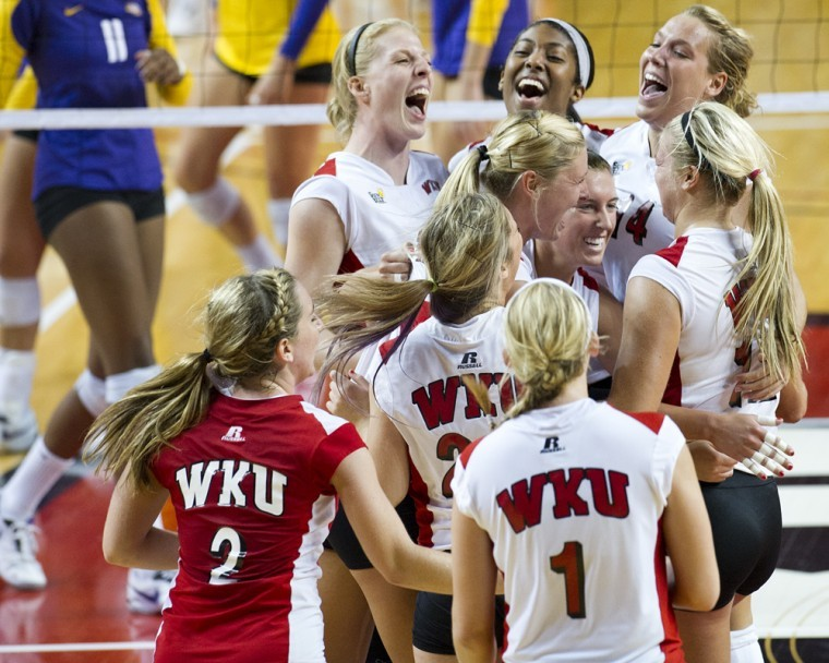 WKU players celebrate their 3-1 victory over LSU at the WKU Tournament in Diddle Arena on Saturday. Undefeated in the tournament, WKU improved its record to 9-1 for the season.