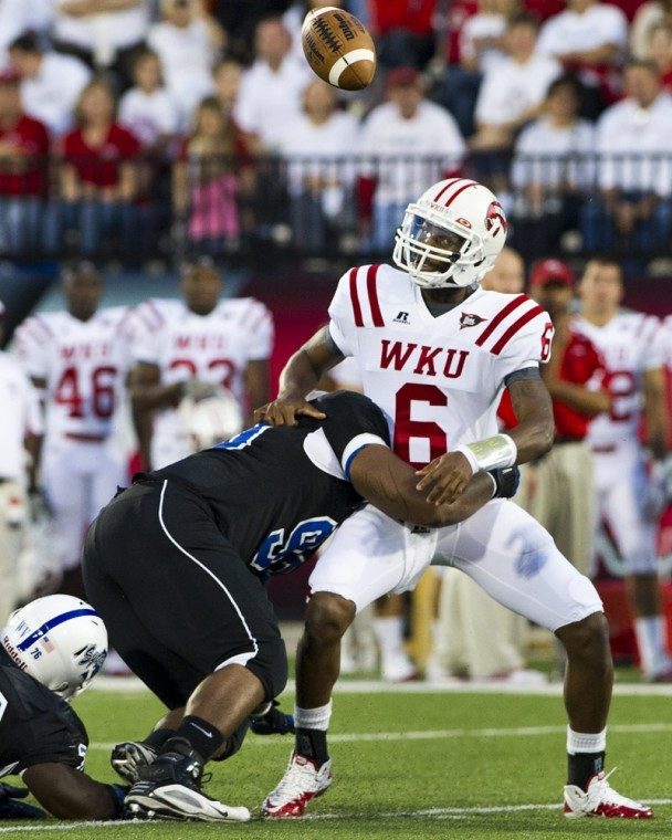 Quarterback Kawaun Jakes fumbles the football while being sacked by Indiana State defensive linebacker Lawrence Young in the second quarter at Smith Stadium.