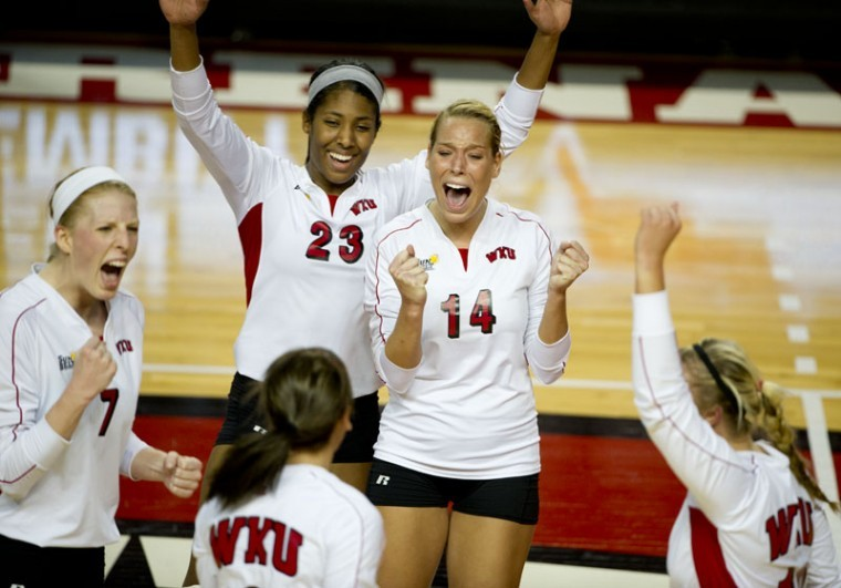 After+scoring+a+point+during+Friday+nights+3-2+win+over+UALR%2C%0AJanee+Diggins+and+Melanie+Stutsman+celebrate+with+their+teammates.%0AWKU+came+back+from+down+two+sets+to+win+3-2+and+extend+its+winning%0Astreak+to+11+matches.%0A