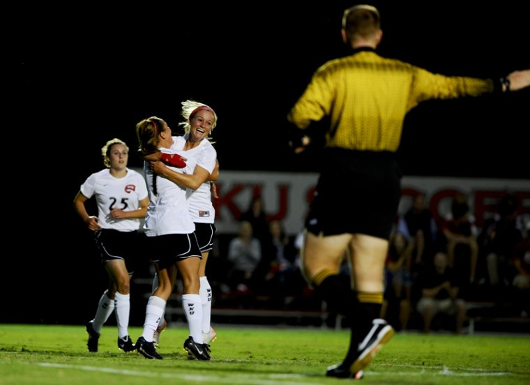 Senior midfielder Kelsey Meyer celebrates with her teammates after one of WKU's four goals against Belmont. The Lady Toppers improved to 4-2 with a 4-0 win over Belmont.