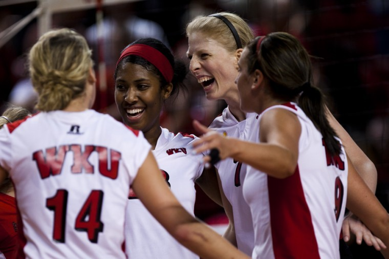 The team joins and cheers after scoring a point during the second set in their game against Arkansas State on Saturday at Diddle Arena. WKU won 3-0 to move to 15-1 and increase their winning streak to 12 matches.