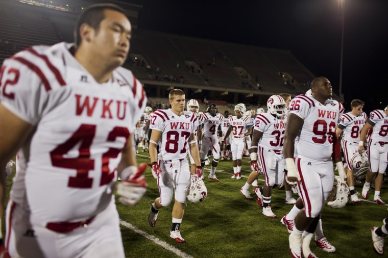 WKU players walk off the field after shaking hands with Indiana State players after their game on Saturday. WKU lost 44-16.