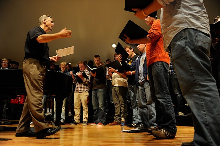 Director of Choral Activities Dr. Paul Hondorp instructs students during a men's chorus practice Wednesday in Ivan Wilson Fine Arts Center.
