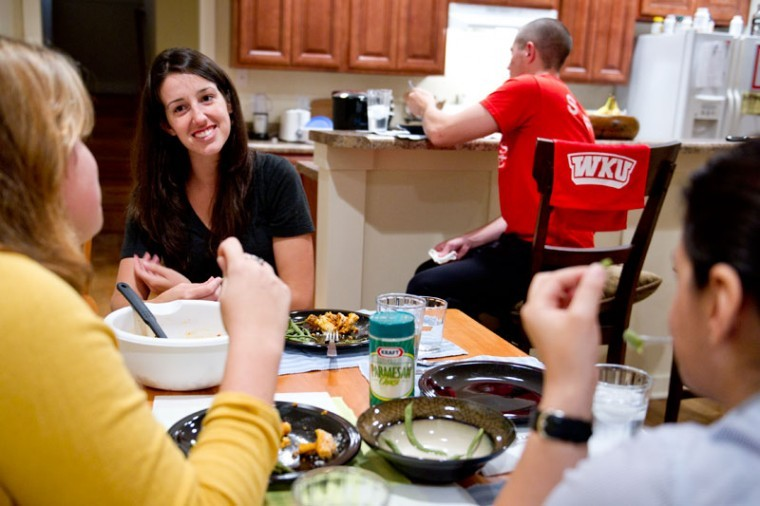 Graduate students (from left to right) Jacqulynn Skaggs from Louisville, Amelia Harshfield from Wichita, Kan., John Roberts, Scottsville, and Elcin Celik, Ankara, Turkey, started a tradition of eating a home cooked meal once a week together. The Hill House, which is part of WKU ALIVE Center and the Institute for Citizenship and Social Responsibility, houses each of the students.