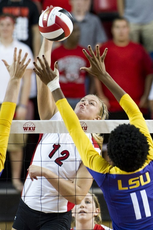 Jordyn+Skinner+%2812%29+spikes+the+ball+past+LSU%27s+defense+for+a%0Apoint+in+the+first+set+during+the+WKU+Tournament+at+Diddle+Arena+on%0ASaturday.%0A