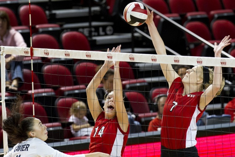 Senior+middle+hitter+Tiffany+Elmore+%287%29+blocks+the+spike+of%0AXaviers+Ame+White+%2811%29+for+a+point+during+the+second+set+at+the%0AWKU+Tournament+on+Friday.+WKU+won+3-1.%0A
