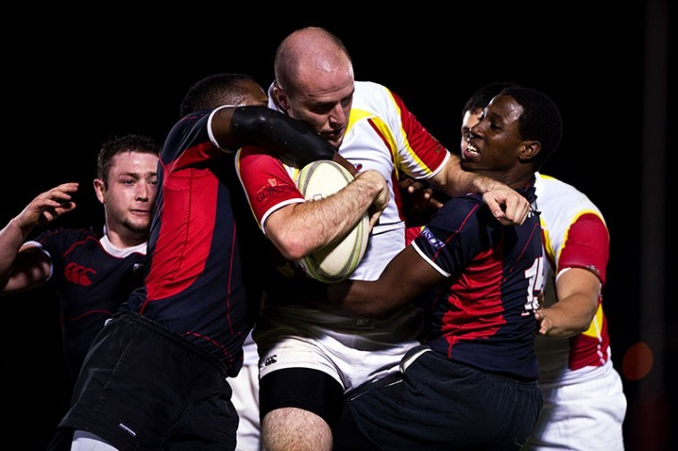 WKU rugby players attempt to take down one of Hopkinsville's runners and eventually run him out of bounds. The rugby match was part of the WKU sport clubs opening weekend of events.