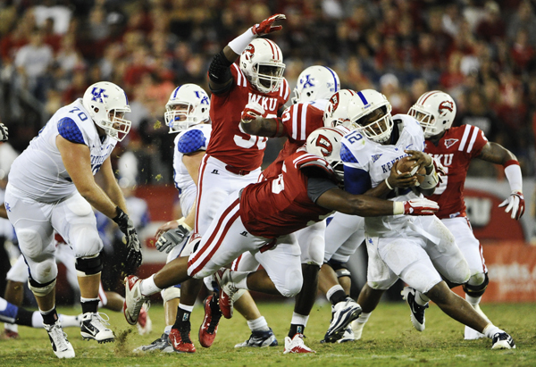 WKU's defense held UK to less than 50 first half yards Thursday night in the teams' season opener at L.P. Field in Nashville.