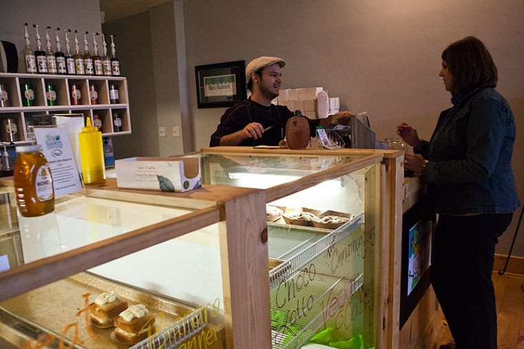 Ashley Chance Fox, assistant professor of American Sign Language purchases tea and a smoothie on Monday from Tea Squares in Downtown Bowling Green. Louisville senior Justin Wuetcher, an employee and former student of Chance Fox, told her about the new shop because they both consider themselves tea snobs.