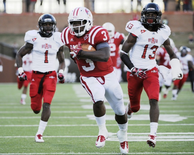 Running+back+Bobby+Rainey+catches+a+touchdown+pass%0Aduring+WKU%27s+26-22+loss+to+Arkansas+State+Oct.+1.+Rainey+and+the%0AToppers+take+on+Sun+Belt+Conference+leader+Louisiana-Lafayette+at+3%0Ap.m.+Saturday+in+Smith+Stadium.%0A