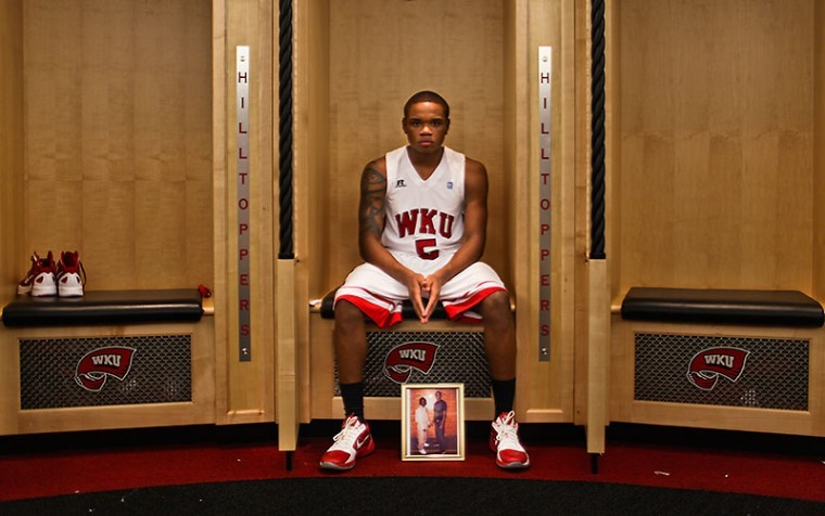WKU+freshman+guard+Derrick+Gordon+sits+by+a+photo+of%0Ahim+and+his+fraternal+twin+brother%2C+Darryl%2C+at+his+locker+in+Diddle%0AArena.+Derrick+has+dedicated+his+basketball+career+to+Darryl%2C+who%0Ahas+been+in+prison+since+2009+for+attempted+murder.%0A