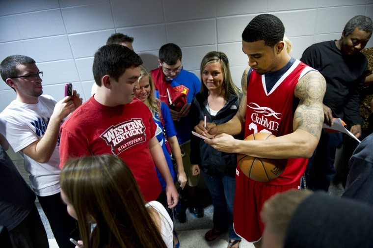 WKU+alum+Courtney+Lee+signs+autographs+for+fans+after+the+press%0Aconference+for+the+Big+Red+vs.+Big+Blue+alumni+game+at+Diddle+Arena%0ATuesday+night.%0A