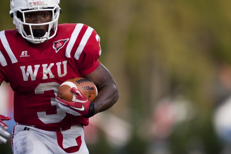 Senior+running+back+Bobby+Rainey+runs+for+a+touchdown+during+the%0Athird+quarter+of+WKU%27s+42-23+win+over+Louisiana-Lafayette+Saturday%0Anight.+It+was+WKU%27s+first+home+win+since+2008.%0A