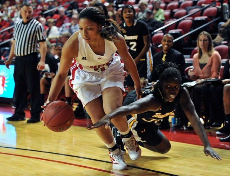 WKU's offense and Towson's defense fight for a loose ball Saturday during WKU's 67-62 loss to Towson at Diddle Arena.