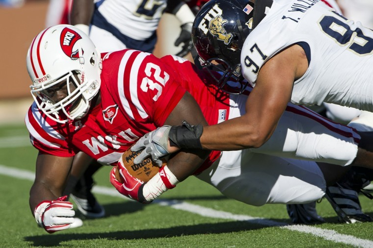 WKU sophomore runningback Kadeem Jones crosses the line for a touchdown in the first quarter agaisnt FIU at Smith Stadium on Nov. 5, 2011. WKU won 10-9 on Casey Tinius' last-second field goal.