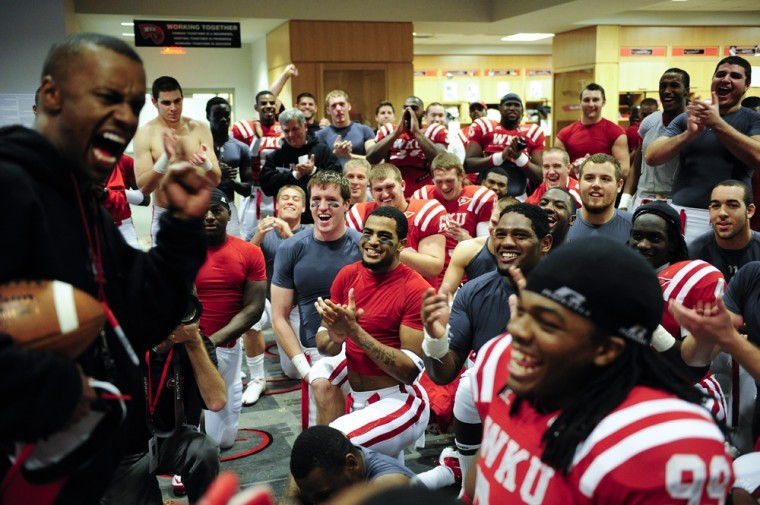 WKU+players+an+coaches+celebrate+in+the+locker+room+Saturday%0Aafter+WKU%27s+41-18+win+over+Troy.%0A