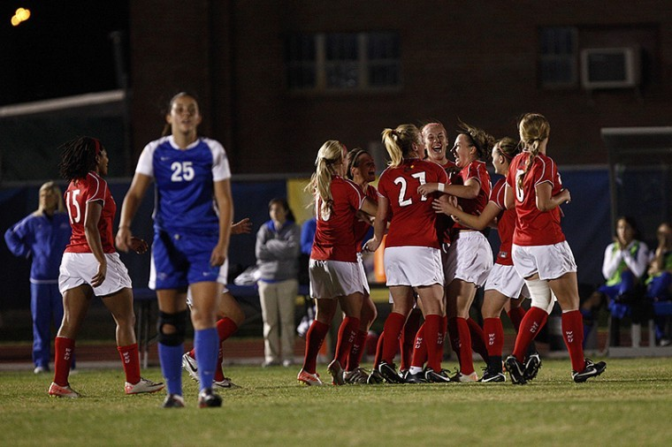 WKU's soccer team celebrates after scoring a goal during the first half of their quarterfinal match Wednesday. The Lady Toppers won and advanced to play North Texas on Thursday.