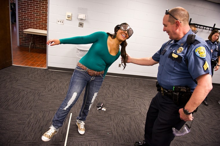 Campus+police+patrol+sergeant+Ricky+Powell+guides+Louisville%0Asophomore+Sydnie+Wright+as+she+attempts+to+walk+in+a+straight+line%0ATuesday+while+wearing+drunk+goggles.+%22If+you%27ve+ever+driven%0Aimpaired%2C+you%27re+gonna+see+what+it%27s+like%2C%22+Powell+told+students.%0A%22And+I+hope+you+haven%27t.%22+Administrators+and+members+from+campus%0Apolice+gathered+in+the+lobby+of+DUC+to+raise+awareness+about%0Aalcohol+intoxication+and+drunk+driving.%0A