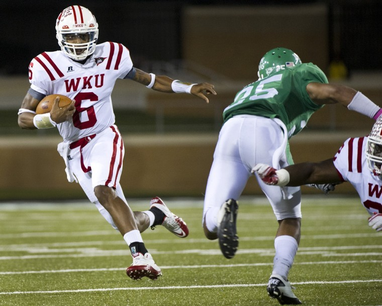Junior+quarterback+Kawaun+Jakes+scrambles+and+runs+the+ball+for%0Aa+gain+in+the+second+quarter+at+Apogee+Stadium+in+Denton%2C+Texas+on%0ASaturday.+Jakes+went+19-of-29+for+231+yards+and+a+career-high+three%0Atouchdowns.+WKU+won+31-21+to+become+bowl+eligible.%0A