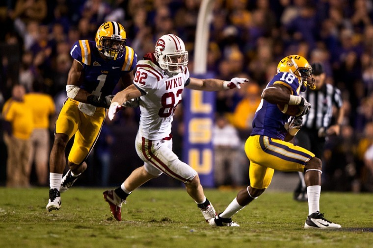 WKU+tight+end+Jack+Doyle+%2882%29+reaches+to+tackle+LSU+safety%0ABrandon+Taylor+%2882%29+after+Taylor+intercepted+a+pass+by+WKU%0Aquarterback+Kawaun+Jakes+during+the+Hilltoppers+42-9+loss+to+the%0ATigers+Saturday+at+Tiger+Stadium+in+Baton+Rouge%2C+La.%0A