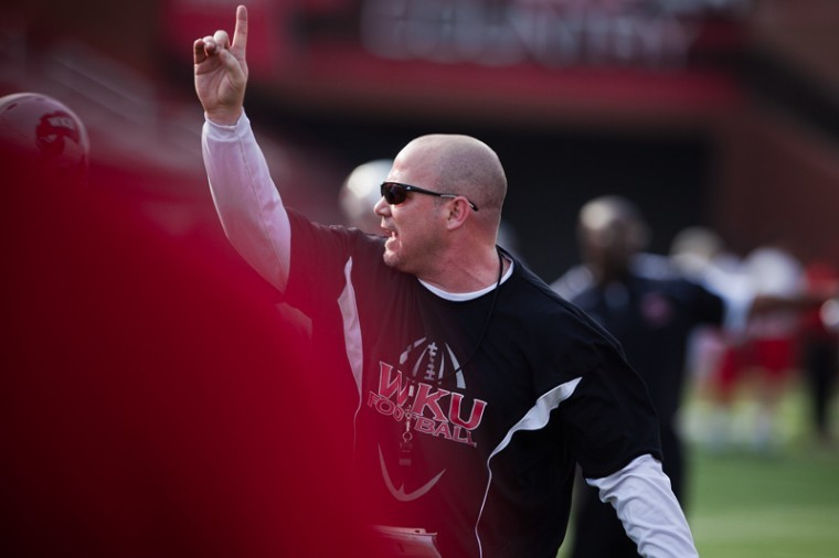 Defensive coordinator Lance Guidry runs through drills during a WKU practice. Guidry was arrested early Saturday morning in Baton Rouge for driving while intoxicated.