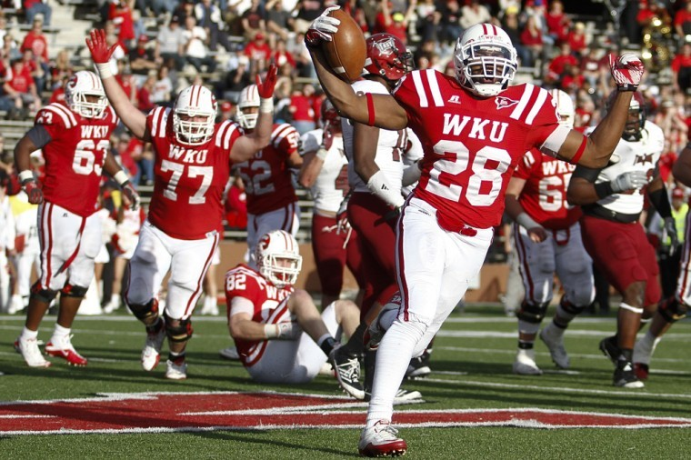 Senior+running+back+Braxston+Miller+celebrates+after+a+touchdown%0Ain+WKU%27s+41-18+win+over+Troy.%0A