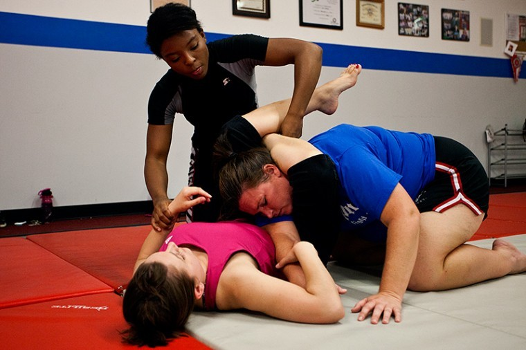 Shakia+Harris%2C+top%2C+balances+her+passion+with+her+career.+She+is%0Aa+mixed+martial+arts+fighter%2C+holds+blue+belt+in+Jiu+Jitsu+and%0Abalances+teaching+self-defense+at+the+Olympic+Gym+during+the+week.%0ABeing+able+to+maintain+her+student+life+as+a+junior+majoring+in%0Aspecial+education+is+what+keeps+her+going.%0A