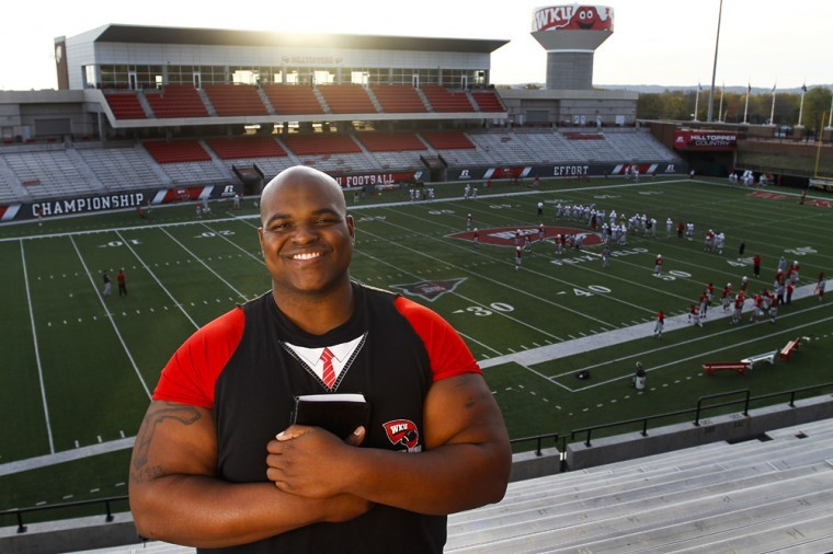 """Sean Pugh, a 2006 WKU graduate, is the character coach, or chaplain, for the football team. Pugh is in his fourth season doing the job. """"I get to impact peoples' lives — be a resource to young people,"""" he said."""