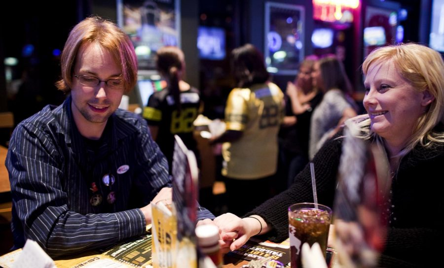 Bowling Green sophomore Brandon Peay, a mayorial candidate, holds hands with girlfriend and New Orleans sophomore Kristin Thames on Tuesday at Buffalo Wild Wings after hearing election results. Peay received 266 votes, good enough for 3.18 percent of the vote.
