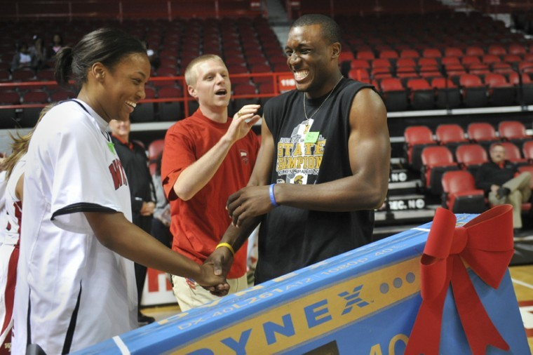 Freshman guard T.J. Price beat out senior forward Teranie Thomas for a 40-inch television Saturday by winning a basketball knockout contest that attempeted to break a Guiness world record. Fewer than 200 people participated in the game, and 380 were needed to set a record.