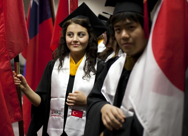 International+student+Funda+Ekiz%2C+left%2C+from+Turkey%2C+and+Daigo%0AHasegawa%2C+from+Japan%2C+get+ready+to+proceed+into+the+graduate%0Acommencement+ceremony+with+their+country%27s+flags.+The+ceremony+was%0Ahosted+at+Diddle+Arena+on+Dec.+16%2C+2011.%0A
