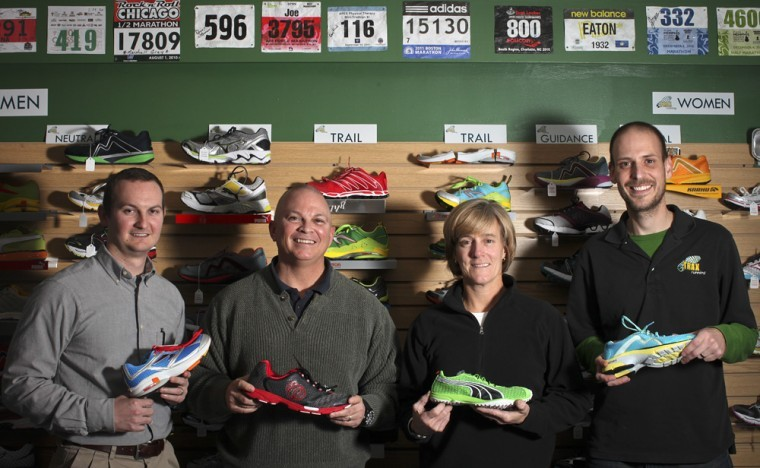Owners of TRAXRunning (left to right) Nick Wheet, Joe Wheet, Lilly Wheet and Chris Healey opened the location last August. The store is the first of its kind to specialize in running shoes and apparel in Bowling Green.