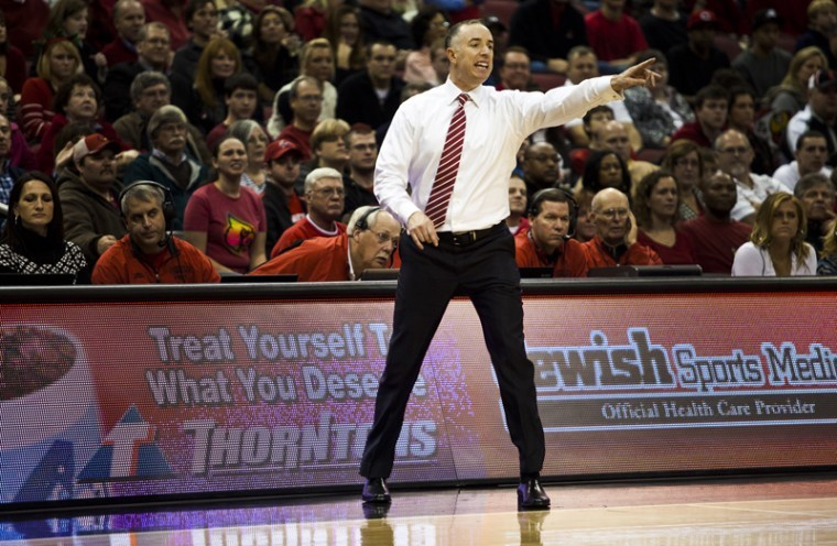 WKU head coach Ken McDonald directs his team during the second half of WKUs game against No. 4 Louisville at the KFC Yum! Center on Friday. WKU lost the game 70-60. The Toppers open Sun Belt Conference play Thursday night against Louisiana-Monroe.