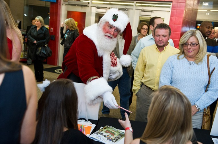 Bob+Karrick%2C+dressed+as+Santa+Claus%2C+handed+out+candy+canes%0AFriday+to+the+sisters+of+Alpha+Omicron+Pi+and+other+attendees+of%0Athe+National+Corvette+Museum%E2%80%99s+second+Holiday+Bash.%0A