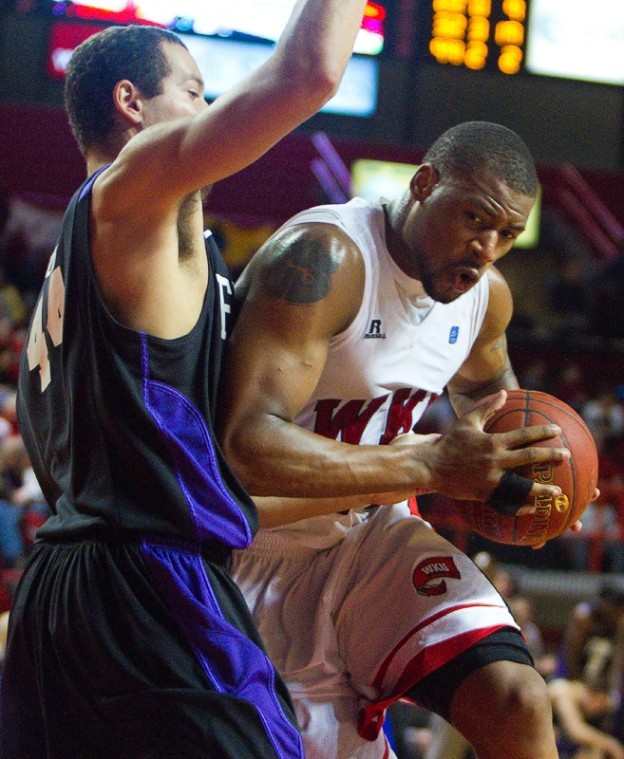 Freshman forward George Fant drives to the basket on Furmans Chris Toler. WKU lost 76-63 to fall to 4-8 on the season.