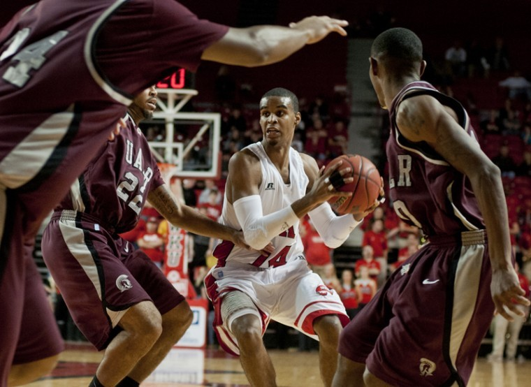 Junior guard Jamal Crook is blocked by University of Arkansas at Little Rock players Ben Dillard, Reggie Fondren and Courtney Jackson while trying to make a shot in the last minutes of a game Jan. 21.