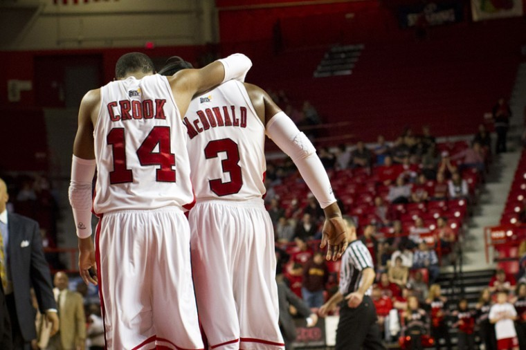 Junior guard Jamal Crook walks teammate senior guard Kahlil McDonald (right) off the court during the basketball game against Louisiana-Lafayette at Diddle Arena on Thursday. Louisiana-Lafayette won the game in overtime with a final score of 72-70 despite ULL playing the final possession with six players on the court.