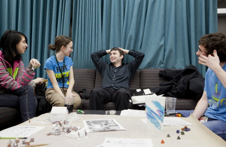 John Law, center, WKU alumni and 'Dungeon Master', relaxes during a 4x4 table top version of the game Suikoden. Along with being the leader of the game as the Dungeon Master, Law also developed the storyline and rules of the game. It's an altered version of Dungeons and Dragons, where the player uses a system of runes to create their character.