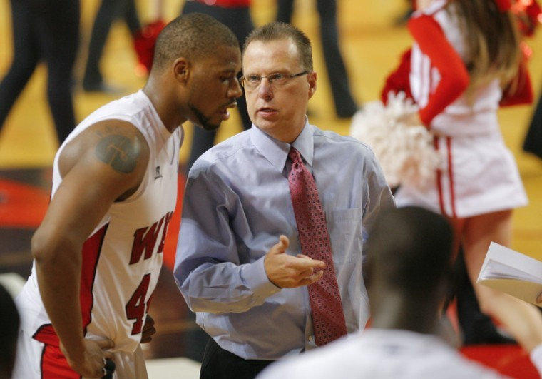 Interim Head Coach Ray Harper speaks with freshman forward George Fant during a timeout Saturday. WKU lost Troy 67-65.