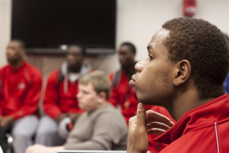 Freshman guard Derrick Gordon watches Fridays press conference where Athletics Director Ross Bjork announced that Head Coach Ken McDonald was fired and would be replaced in the interim by Assistant Coach Ray Harper. They were given the news of Head Coach Ken McDonalds dismissal earlier in the morning on Friday, Jan. 6. Before the conference ended the team was dismissed to begin preparing for practice.