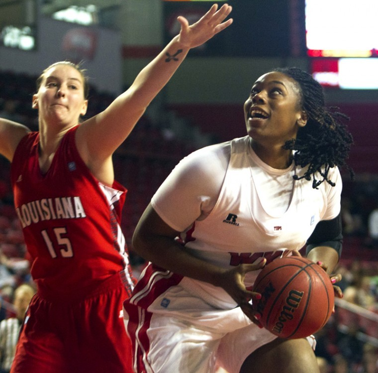 WKU+senior+Keshia+Mosley+works+her+way+past%0ALouisiana-Lafayette%27s+defense+to+shoot+a+field+goal+during+their%0Agame+on+Wed.%2C+Jan.+4+at+Diddle+Arena.+WKU+won+49-45.%0A