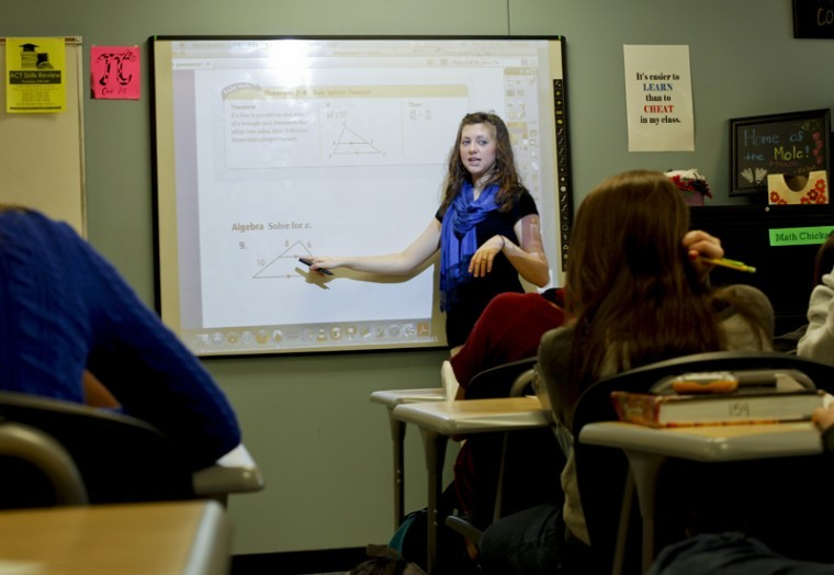 Lawrenceburg senior Kayla Fawbush student teaches sophomore geometry classes at South Warren High School. Fawbush said double majoring in Mathematics and Science and Math Education has helped prepare her for student teaching.